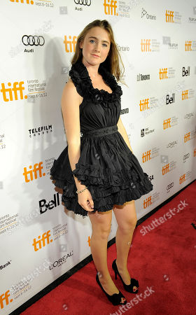 """Emma Holzer, a cast member in """"What Maisie Knew,"""" poses at the premiere of the film at the 2012 Toronto Film Festival, in Toronto"""