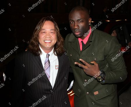 Cliff Nguyen manger of BMW Beverly Hills seen with Sam Sarpong named Star of The Year at 2013 Men's Style Fashion Awards at Fatty's Bar and Restaurant on Saturday, Dec.21, 2013, in West Hollywood. California