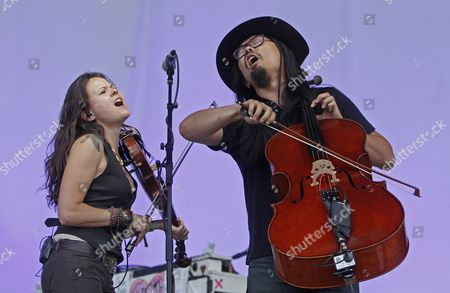 Tania Elizabeth, left, and Joe Kwon of The Avett Brothers perform at the Bonnaroo Music and Arts Festival, in Manchester, Tenn