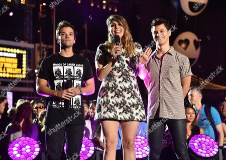 Stock Image of Nathan Kress, and from left, Molly Tarlov, and Michael Willet introduce G-Eazy on stage at the mtvU Fandom Awards at MTV Fan Fest at Comic-Con, in San Diego