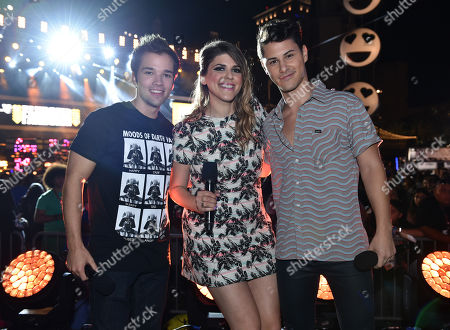 Nathan Kress, and from left, Molly Tarlov, and Michael Willet introduce G-Eazy on stage at the mtvU Fandom Awards at MTV Fan Fest at Comic-Con, in San Diego