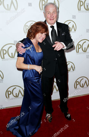 Jerry Weintraub, right, and Susan Ekins arrive at the 25th annual Producers Guild of America Awards at the Beverly Hilton Hotel in Beverly Hills, Calif. on