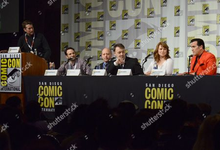 "Scott Aukerman, from left, Craig DiGregorio, Ivan Raimi, Sam Raimi, Lucy Lawless and Bruce Campbell attend the ""Ash vs. Evil Dead"" panel on day 2 of Comic-Con International, in San Diego, Calif"