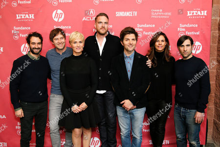 """From left to right, Jay Duplass, executive producer Mark Duplass, actress Judith Godreche, director and writer Patrick Brice, executive producer and actor Adam Scott, producer Naomi Scott and actor Jason Schwartzman pose together at the premiere of """"The Overnight"""" during the 2015 Sundance Film Festival, in Park City, Utah"""
