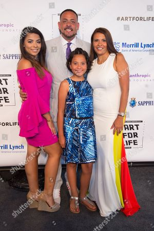 James Cruz and his family arrive at the 2016 Art For Life Benefit, presented by Russell Simmonsâ?™ RUSH Philanthropic Arts Foundation, at Fairview Farms,, in Water Mill, New York