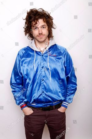 """Actor, writer, and filmmaker, Andre Hyland, poses for a portrait to promote the film, """"The 4th,"""" at the Toyota Mirai Music Lodge during the Sundance Film Festival on in Park City, Utah"""