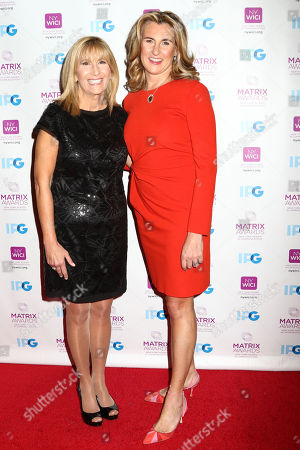 Honoree Nancy Dubuc, President and CEO of A+E Networks, right, and Jamie Gangel attend the 2016 New York Women in Communications Matrix Awards at the Waldorf Astoria, in New York