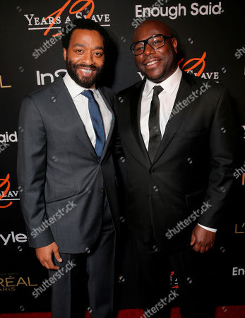 "Chiwetel Ejiofor, left, and Steve McQueen attend a cocktail party hosted by Ariel Foxman, the editors of InStyle, and Fox Searchlight Pictures to celebrate the Golden Globe nominations for ""12 Years a Slave"" and ""Enough Said"", at Chi Lin in West Hollywood, Calif"