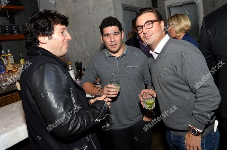 President and Head of A&R at SONGS Ron Perry, left, and Billboard Group's John Amato, right, seen with a guest at Billboard Magazine's Celebration of '40 Under 40' at Toro Restaurant on in New York City