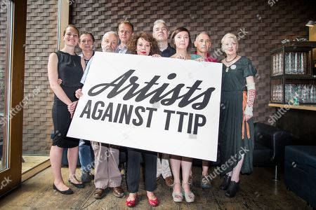 From left, Carrie Cracknell, Mike Leigh, Nick Dearden, Helen McCrory, John Hilary, Vicky Featherstone, Mark Rylance and Dame Vivienne Westwood pose for photographers during a photocall for the launch of Artists Against the Transatlantic Trade and Investment Partnership, TTIP, at the Young Vic Theatre in London, . The TTIP is a comprehensive free trade and investment treaty currently being negotiated between the European Union and the USA