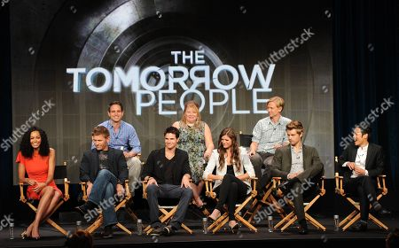 "Stock Image of From top left, executive producers Greg Berlani, Julie Plec, Phil Klemmer and actors Aaron Yoo, Luke Mitchell, Peyton List, Robbie Amell, Mark Pellegrino and Madeline Mantock participate in the ""The Tomorrow People"" panel at the 2013 CW Summer TCA Press Tour at the Beverly Hilton Hotel on in Beverly Hills, Calif"