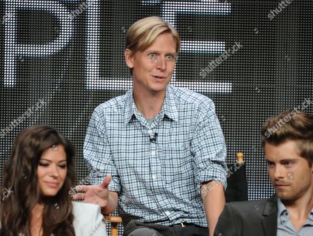 """Executive producer Phil Klemmer, center, participates in the """"The Tomorrow People"""" panel at the 2013 CW Summer TCA Press Tour at the Beverly Hilton Hotel on in Beverly Hills, Calif"""
