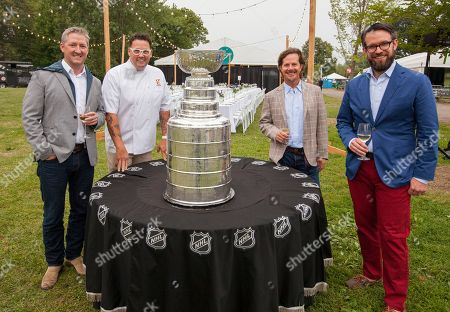 Tim Love, Graham Elliot, Charlie Jones and Danny Wirtz with the Stanley Cup at the Feast Under the Stars event during the Chicago Food + Wine Festival, in Chicago