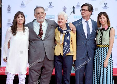 Talia Shire, from left, honoree Francis Ford Coppola, Eleanor Coppola, Roman Coppola and Gia Coppola pose during a handprint and footprint ceremony at the TCL Chinese Theater, in Los Angeles