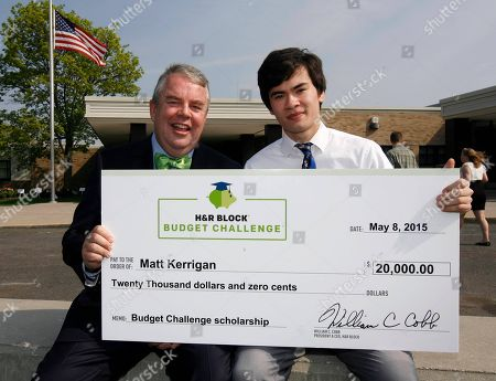 Stock Photo of H&R Block CEO Bill Cobb, left, with $20,000 scholarship winner Matt Kerrigan, 17, at the H&R Block Budget Challenge winner presentation at St. Clair High School, on in St. Clair, Mi