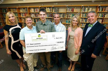 From left, H&R Block CMO Kathy Collins, mother Diane Lawrence, winner Sean Lawrence, father Steve Lawrence, teacher Amanda Volz and H&R Block CEO Bill Cobb during the H&R Block Budget Challenge $120,000 scholarship winner presentation at St. Clair High School, on in St. Clair, Mi