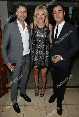 Justin Theroux, right, Malin Akerman, left, and Colin Egglesfield pose for a photo as Justin Theroux and Dan Peres celebrate the August issue of DETAILS at The Sunset Tower Hotel on in West Hollywood, Calif