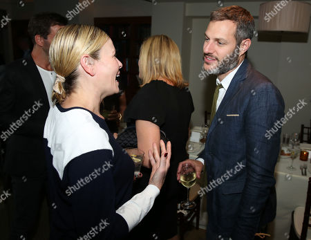 Chelsea Handler, left, and Michael Morris are seen as Justin Theroux and Dan Peres celebrate the August issue of DETAILS at The Sunset Tower Hotel on in West Hollywood, Calif