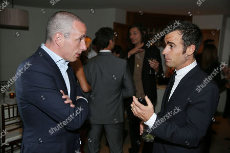 Justin Theroux, right, and Dan Peres are seen as they celebrate the August issue of DETAILS at The Sunset Tower Hotel on in West Hollywood, Calif