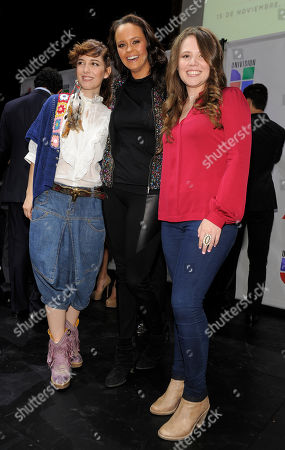Maria Barracuda, left, of Mexican pop group Jotdog, Spanish singer Shaila Durcal, center, and Joy Huerta of Mexican pop duo Jesse & Joy pose together following The XIII Annual Latin Grammy Awards nominations at the Belasco Theater, in Los Angeles. The show will be held on Nov. 15 in Las Vegas