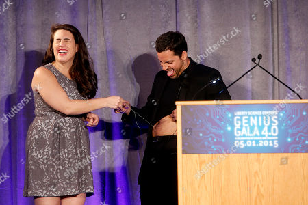 "David Blaine performs onstage with a guest at the Liberty Science Center Genius Gala 4.0 where Jeff Bezos, Founder and Chairman of Amazon, Vinton Cerf, Chief Internet Evangelist at Google and Father of the internet, and Jill Tarter, astronomer and SETI researcher of ""Contact"" fame, are honored on Fri., in Jersey City, N.J. The gala, hosted by Center President Paul Hoffman, also pays tribute to former NJ Governor Tom Kean on his 80th birthday and features a special performance by magician/ illusionist David Blaine, and raises funds to support the Center's vast array of exhibitions, educational programs, and community initiatives"