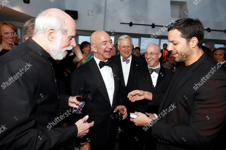 "From Right, David Blaine performs for Jeff Bezos, and Vinton Cerf at the Liberty Science Center Genius Gala 4.0 where Jeff Bezos, Founder and Chairman of Amazon, Vinton Cerf, Chief Internet Evangelist at Google and Father of the internet, and Jill Tarter, astronomer and SETI researcher of ""Contact"" fame, are honored on Fri., in Jersey City, N.J. The gala, hosted by Center President Paul Hoffman, also pays tribute to former NJ Governor Tom Kean on his 80th birthday and features a special performance by magician/ illusionist David Blaine, and raises funds to support the Center's vast array of exhibitions, educational programs, and community initiatives"
