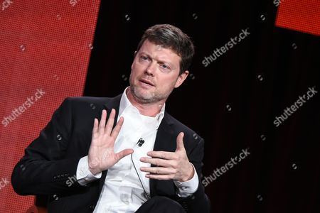 """George Nolfi speaks on stage during the """"Allegiance"""" panel at the NBC 2015 Winter TCA, in Pasadena, Calif"""