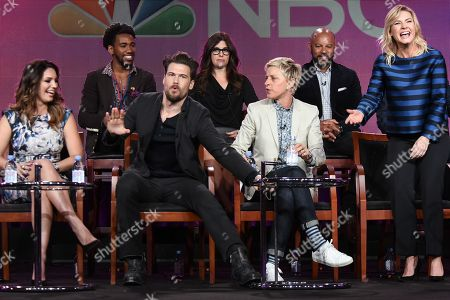 """From left, Kelly Brook, Brandon Smith, Nick Zano, Rebecca Corry, Ellen DeGeneres, Chris Williams, and Elisha Cuthbert speak on stage during the """"One Big Happy"""" panel at the NBC 2015 Winter TCA, in Pasadena, Calif"""