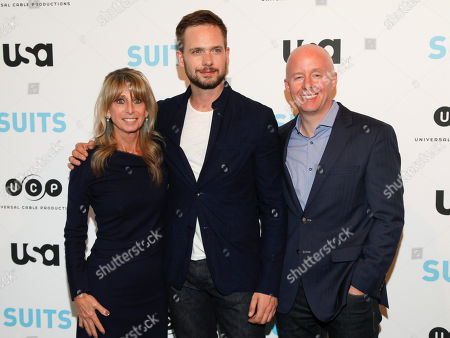 "NBCUniversal Cable Entertainment Group chairman Bonnie Hammer, from left, Patrick J. Adams and USA Network president Chris McCumber arrive at ""Behind The Lens: An Intimate Look At The World Of Suits"" at the Meatpacking District Gallery, in New York"