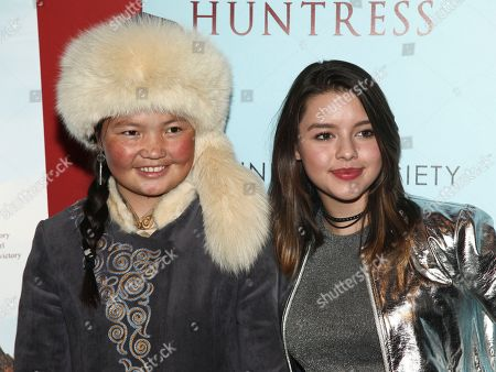 "Aisholpan, left, and Fatima Ptacek, right, attend a special screening of ""The Eagle Huntress"" at the Landmark Sunshine Cinema, in New York"