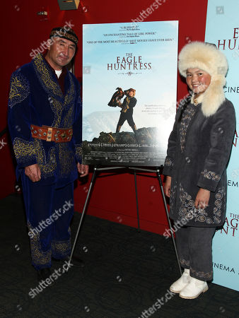 "Nurgaiv Rys, left, and Aisholpan, right, attend a special screening of ""The Eagle Huntress"" at the Landmark Sunshine Cinema, in New York"