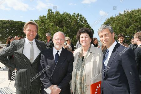 From left, Timothy Potts, Director, J. Paul Getty Museum; Jim Cuno, President and CEO, J. Paul Getty Trust, Debora Marrow, Director The Getty Foundation and Michael Govan, CEO Los Angeles County Museum of Art and Wallis Annenberg Director pose during a press conference for Pacific Standard Time Presents: Modern Architecture in L.A. launch and press preview for Overdrive: L.A. Constructs the Future, 1940-1990 and In Focus: Ed Ruscha held at the Getty Center on in Los Angeles, California