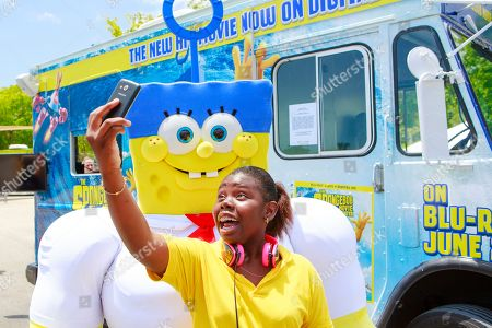 SpongeBob SquarePants' superhero alter-ego Invincibubble poses for a selfie with a fan on at Zoo Miami in Miami, Florida to celebrate the home entertainment debut of the blockbuster hit film The SpongeBob Movie: Sponge Out Of Water. The event kicked off an 8-city tour that will conclude in Los Angeles on June 2, 2015 to coincide with the film's Blu-ray debut