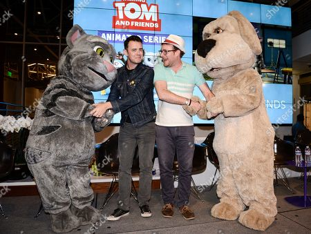 """Actor Colin Hanks, left center, and actor James Adomian greet the characters they voice, Talking Tom, left, and Talking Ben at the premiere screening of the """"Talking Tom and Friends"""" animated series at YouTube Space LA on in Los Angeles. The series debuts today on YouTube"""