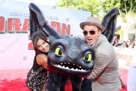 Kelly Paniagua and Julian McMahon seen at the Twentieth Century Fox and DreamWorks Animation Los Angeles Premiere of 'How to Train Your Dragon 2', in Westwood, Calif