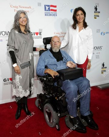Chuck Close, guests. Artist Chuck Close, center, and guests attend the 11th Annual Stand Up for Heroes benefit, presented by the New York Comedy Festival and The Bob Woodruff Foundation, at the Theater at Madison Square Garden, in New York