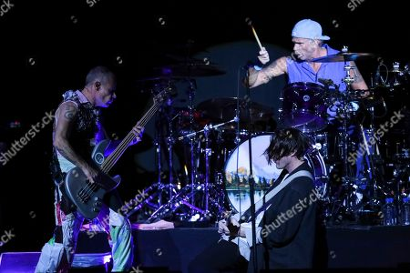 Stock Picture of Flea, Josh Klinghoffer, Chad Smith. Bassist Flea, from left, guitarist Josh Klinghoffer, and drummer Chad Smith, from The Red Hot Chili Peppers, perform on stage during the 11th Annual Stand Up for Heroes benefit, presented by the New York Comedy Festival and The Bob Woodruff Foundation, at the Theater at Madison Square Garden, in New York