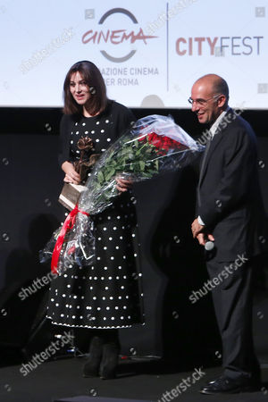 Stock Image of The director Giuseppe Tornatore delivery the Virna Lisi Prize to Monica Bellucci