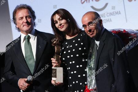 Corrado Pesci, son of Virna Lisi, Monica Bellucci with the Prize, the director Giuseppe Tornatore