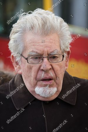Rolf Harris, former television entertainer, arrives at the Royal Courts of Justice with his niece Jenny Harris.