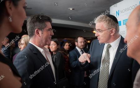Simon Cowell with Daniel Taub, Israeli Ambassador to the UK.