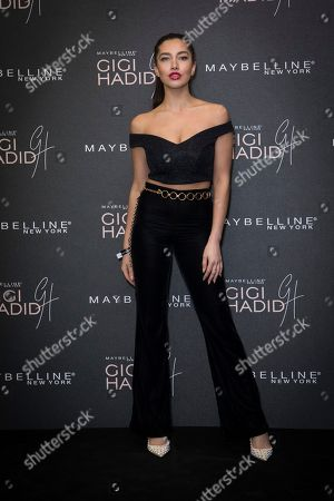 Nadine Hermez poses for photographers upon arrival at the Gigi Maybelline Party, in London