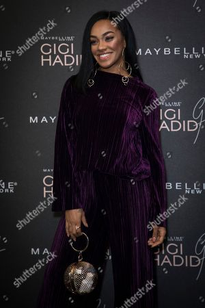 Karis Anderson poses for photographers upon arrival at the Gigi Maybelline Party, in London