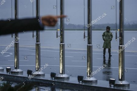 A man (L, out of frame) points his finger as a policeman wearing a raincoat stands guard at the Da Nang International Airport ahead of the 25th Asia-Pacific Economic Cooperation summit (APEC) in Da Nang, Vietnam, 08 November 2017. The APEC summit brings together world leaders from its 21 member nations. It is the second time Vietnam is hosting the summit, the first was in 2006.