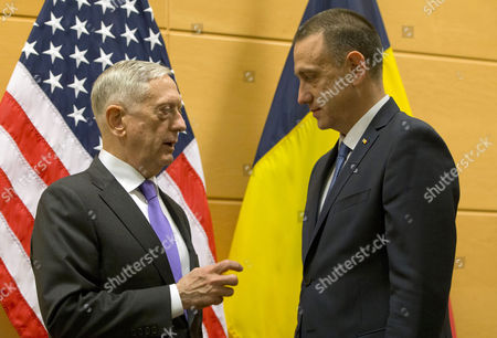 US Secretary for Defence Jim Mattis (L) speaks with Romanian Defence Minister Mihai-Viorel Fifor prior to a meeting on the sidelines of a NATO Defence ministers meeting at NATO headquarters in Brussels, Belgium