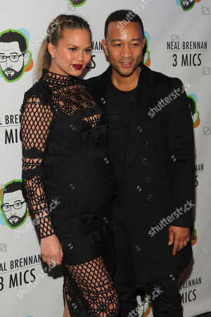 """Stock Photo of Chrissy Teigen, left, and John Legend, right, attend the Broadway opening night party of """"Neal Brennan 3 MICS"""" at The Lynn Redgrave Theater, in New York"""