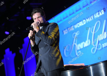 """Michael Johns, American Idol Season 7 contestant, performs at the 12th Annual Starkey Hearing Foundation """"So The World May Hear"""" Gala on in St. Paul, Minnesota"""