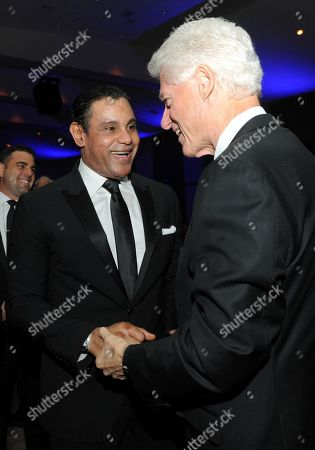 "Sammy Sosa and former President Bill Clinton are seen at the 12th Annual Starkey Hearing Foundation ""So The World May Hear"" Gala on in St. Paul, Minnesota"