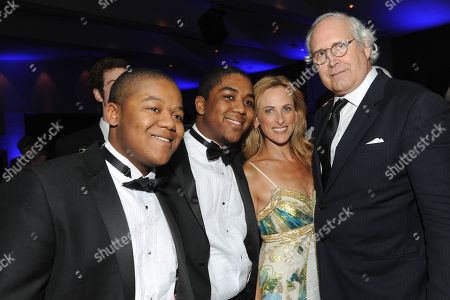 """Kyle Massey (left), Chris Massey, Marlee Matlin and Chevy Chase are seen at the 12th Annual Starkey Hearing Foundation """"So The World May Hear"""" Gala on in St. Paul, Minnesota"""