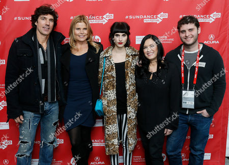 """Cast members, actress Mariel Hemingway, second left, her boyfriend Bobby Williams, left, her daughter Langley Hemingway, center, producer and director Barbara Kopple, second right, and producer Nick Kopple-Perry, right, pose together at the premiere of """"Running From Crazy"""" during the 2013 Sundance Film Festival on in Park City, Utah"""